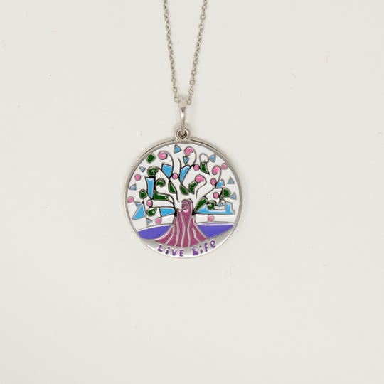 The Growth Roots design locket from the Astor Collection is an example of the jewelry based on drawings by children served by Astor Services for Children & Families.