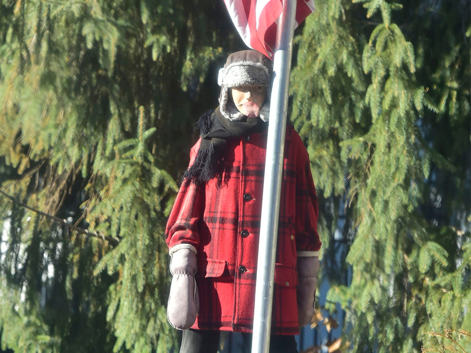 "In what has become a familiar display from the movie ""A Christmas Story,"" Flick put his tongue on a frozen flagpole and gets stuck after being ""triple dog dared."" The Christmas decoration is seen along the 500 block of Philadelphia Avenue in Chambersburg."
