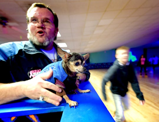 Wally Miller of York City answers questions about his service dog Snickers during an outing with family members at Mr Q's Family Skate Center in West York Wednesday, Nov. 28, 2018. Snickers, a chihuahua, senses drops in blood sugar in Miller, a diabetic. Bill Kalina photo