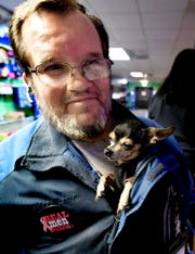 Wally Miller of York City and his service dog Snickers arrive  at an outing with family members at Mr Q's Family Skate Center in West York Wednesday, Nov. 28, 2018. Snickers, a chihuahua, senses drops in blood sugar in Miller, a diabetic. Bill Kalina photo