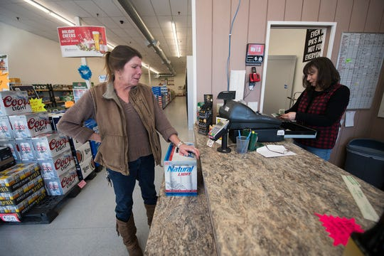 Lori Broyles, left, who has been a customer of Case & Keg in Shrewsbury for about 25 years, followed the store to its new location. Kim Guerrini, right, completes the sale. Changes to rework the Exit 4 interchange at Interstate 83 in 2019 forced the store to relocate after four decades at its original site.