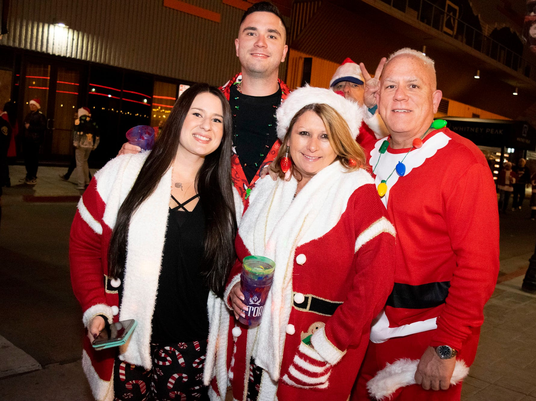 Elves, Christmas trees, Grinches, and yes, Santas, all get merry at the Reno Santa Pub Crawl on Saturday, Dec. 15, 2018. Reno, Nev.
