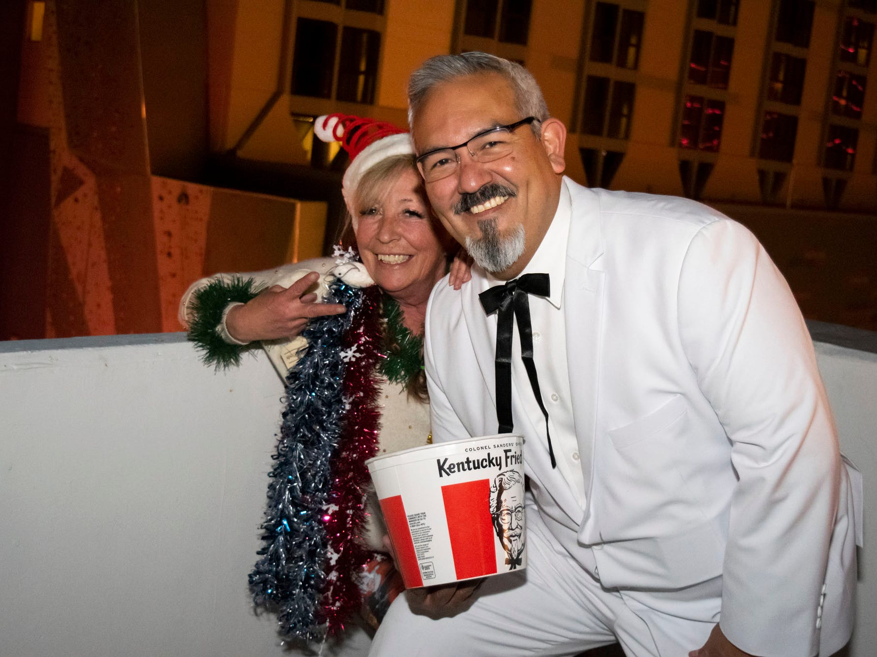 Tom and Carolyn Madrigal get merry at the Reno Santa Pub Crawl on Saturday, Dec. 15, 2018.