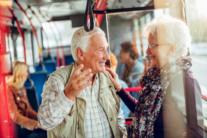 Couple riding on a bus