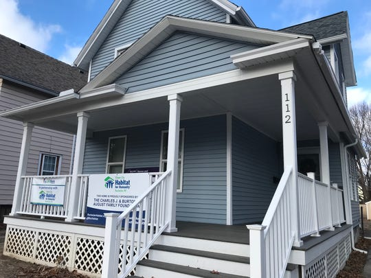 Former vacant home on Parsells Avenue  rehabilitated by Habitat for Humanity