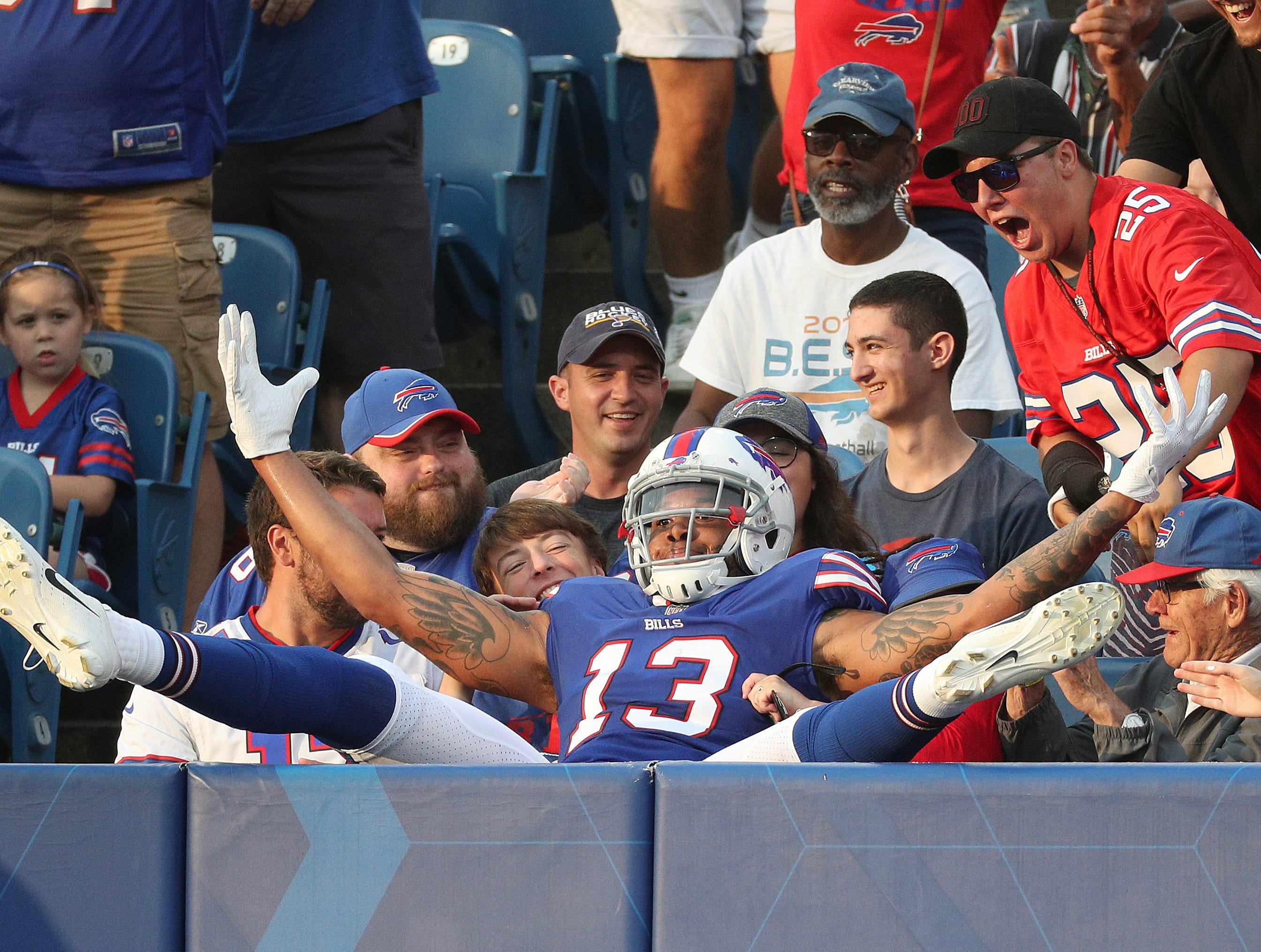 Bills receiver Kelvin Benjamin ends up in the stands after his 28 yard touchdown catch from Nathan Peterman against Carolina.