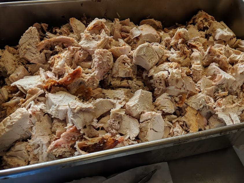 Roast turkey is carved into pieces at A Meal and More. It was used this day to make hot turkey sandwiches.