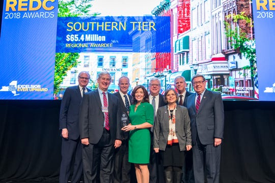 Members of the Southern Tier Regional Council stand with Lt. Gov. Kathy Hochul, center, and ESD head Howard Zemsky, left, after receiving $65.4 million for the region at a ceremony in Albany on Tuesday, Dec. 18, 2018.