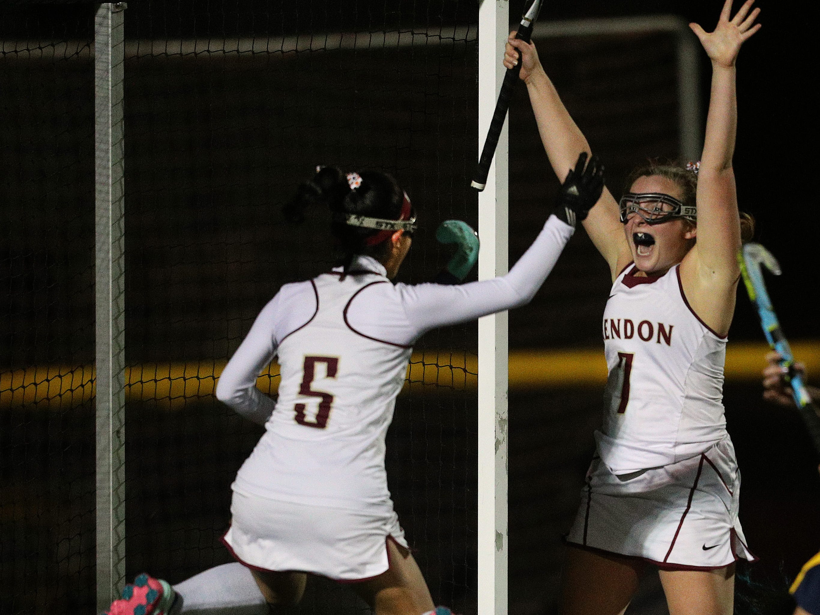 Mendon's Ali Hess (7) celebrates her game winning goal with Julia Zatyko in a 2-1 win over Sutherland in double overtime to win the the Class B title.