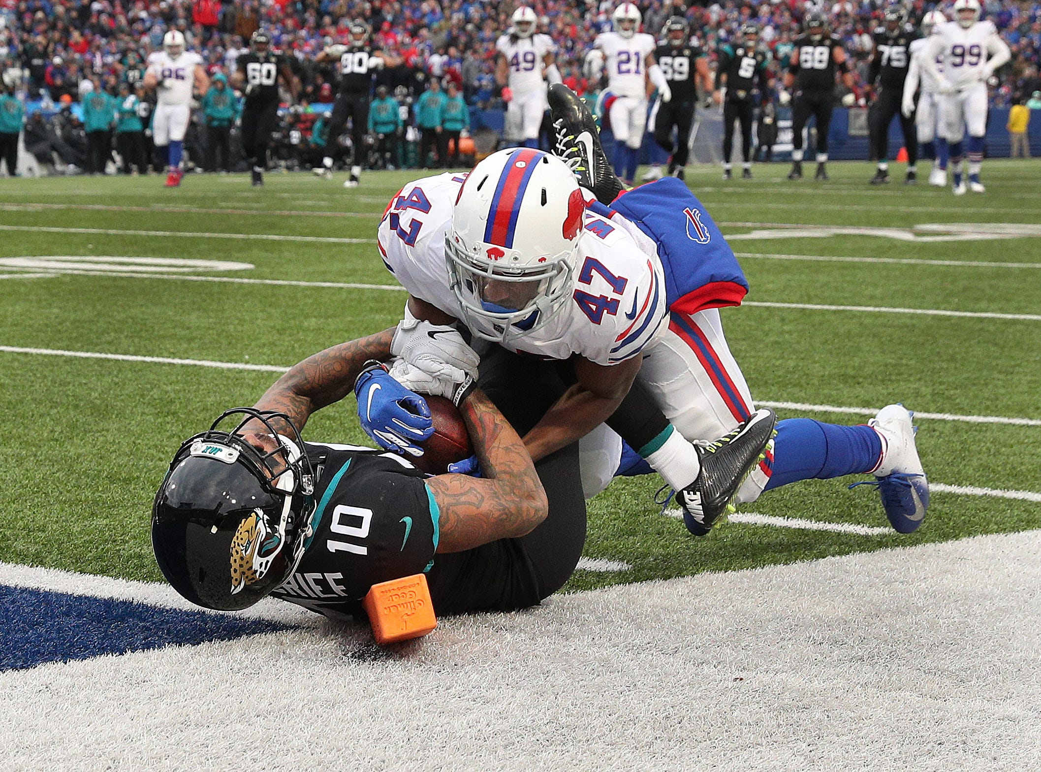 Bills Levi Wallace battles with Jaguars receiver Donte Moncrief for possession.  The pass was ruled a catch with Moncrief down t the 1-yard line.