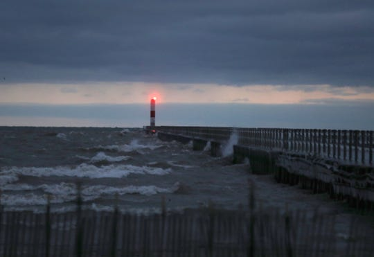 Wind whips the waves on Lake Ontario at Ontario Beach Park Dec. 18, 2018.  The sun was just rising in the horizon,