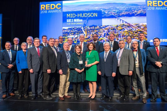 Members of the Mid-Hudson Regional Council stand with Lt. Gov. Kathy Hochul, center, and ESD head Howard Zemsky after receiving $87.1 million for the region at a ceremony in Albany on Tuesday, Dec. 18, 2018.