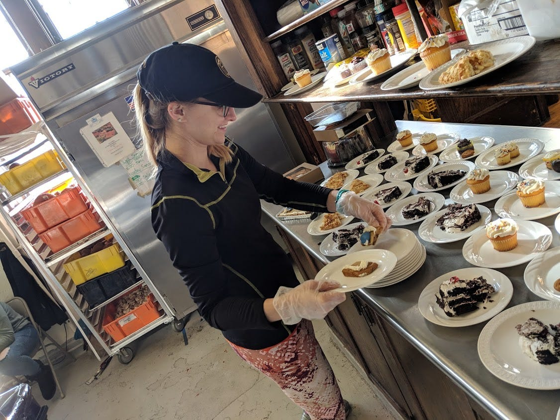 Volunteer Taylor Myers prepares desserts at A Meal and More soup kitchen.  The food program needs volunteers at Christ Church to prep and serve Wednesdays from 10 am to 1:30 pm, and Sundays from 11 am to 2:45 p.m.