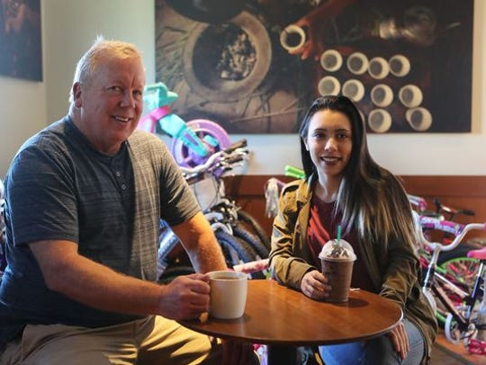 In 2016, Ted Blankenheim and Marie McDonald, 18, sit at the downtown Redding Starbucks. McDonald, who was a foster child, received one of the bikes in the Christmas program that Blankenheim organizes.