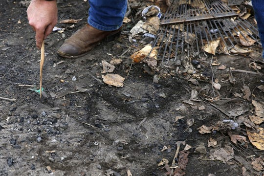 Art Scaglione draws in the dirt the City of Salem and Polk County boundaries as they intersect in Wallace Marine Park while in the park in Salem, Oregon, on Friday, Dec. 7, 2018. Most people living around Wallace Marine Park live on private property owned by a quarry that is within Polk County jurisdiction.