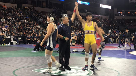 Alfredo Mendoza (yellow) has won the competitive 152-pound weight classes in  earlier this season to test his power before league and state championships.