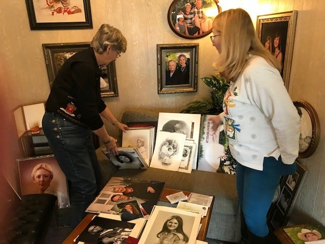 Linda Rasor and Laura Gillis, owners of Barney's Studio, 3111 West Beauregard Ave., showing photos and portraits at the store on Dec. 18, 2018.