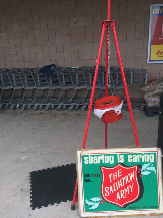 A Salvation Army red kettle sits outside the Exmore, Virginia Food Lion on Saturday, Dec. 15, 2018.