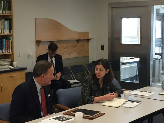 Congresswoman-elect Elaine Luria chats with Sen. Lynwood Lewis at a meeting with Eastern Shore of Virginia officials in Wachapreague, Virginia on Monday, Dec. 17, 2018.