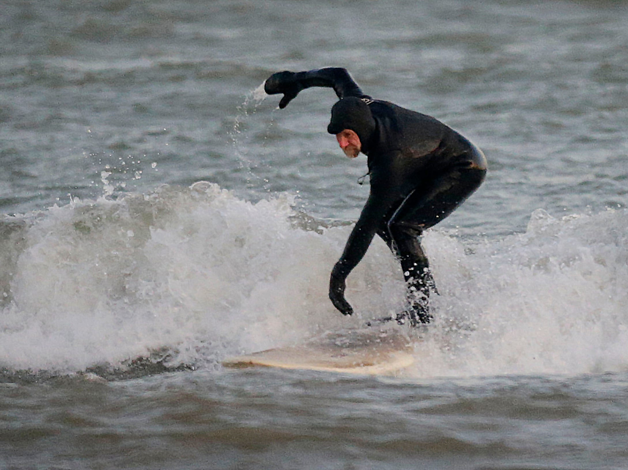 Brian David catches his balance at the lakefront, Tuesday, December 18, 2108, in Sheboygan, Wis.