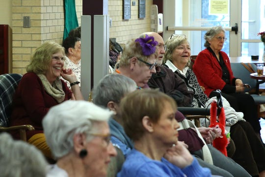 Bonnie Flood laughs at a joke Frank Petereit says between Dancing Diva song performances at Good Samaritan Society-Luther Manor in Sioux Falls, S.D., Friday, Dec. 14, 2018.