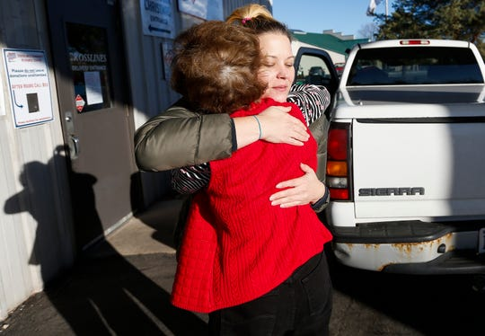 Heather Amundson, right, hugs Sheryl Wachter after loading gifts into her truck during the Share Your Christmas distribution at Crosslines on Tuesday, Dec. 18, 2018. Amundson was receiving gifts for 2 girls, ages 4 and 3, as well as a 2-year-old boy.