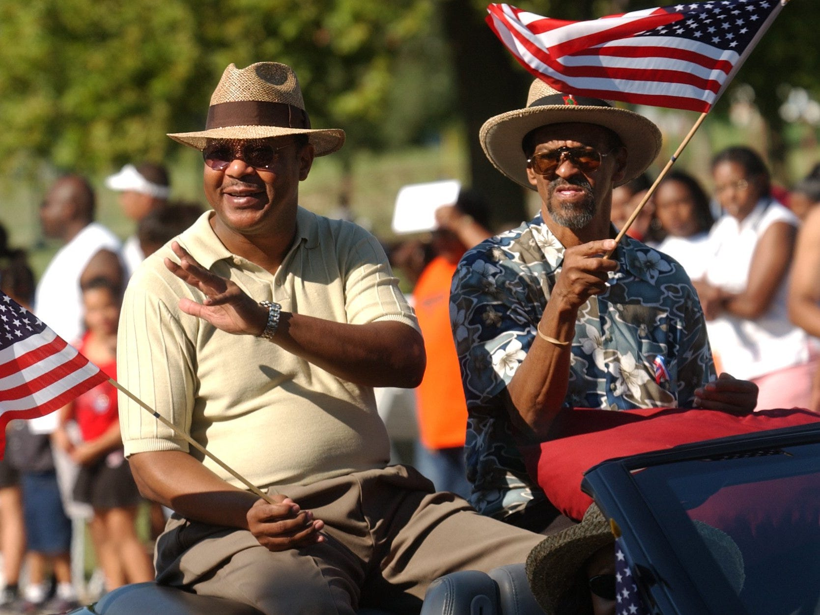 Park Day parade grand marshals Ron Ponds, left, and Denny Whayne wave to the crowd during festivities Saturday afternoon at Silver Springs Park in this 2003 photo.