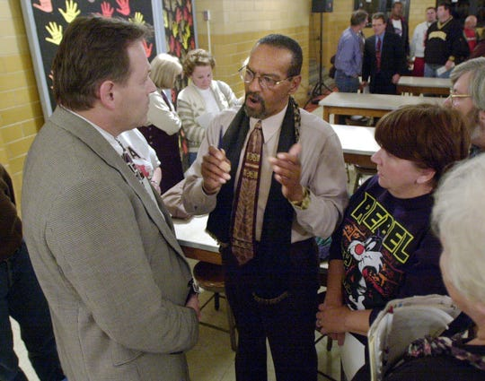 Denny Whayne, center, talks with Springfield Superintendent Jack Ernst after a meeting at Central High School to discuss the state of the school's athletic facilities in this 2000 photo.