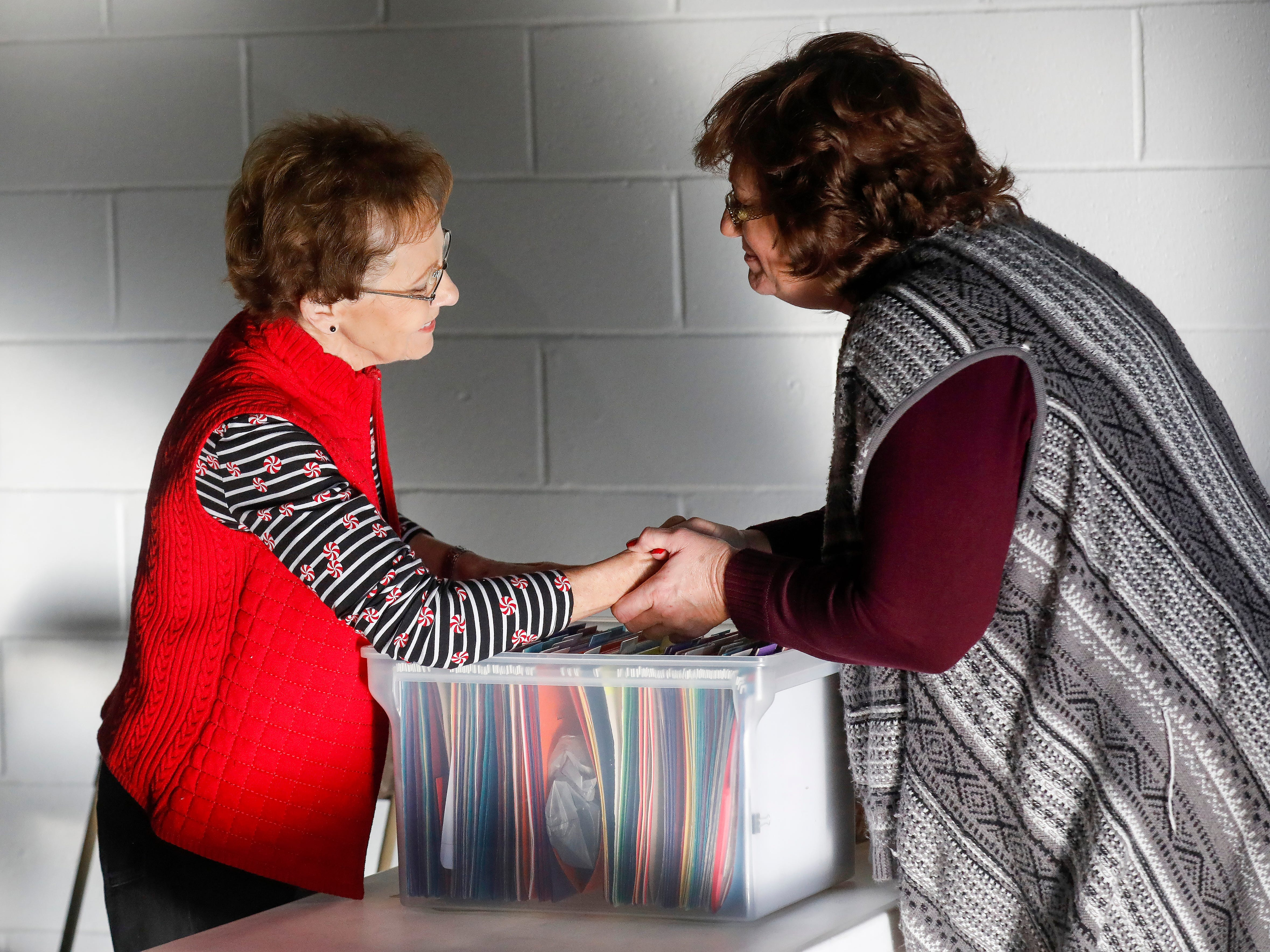 Lorene Guy, right, thanks Sheryl Wachter as she is being checked in during the Share Your Christmas distribution at Crosslines on Tuesday, Dec. 18, 2018. Guy was receiving gifts for her two grandchildren.