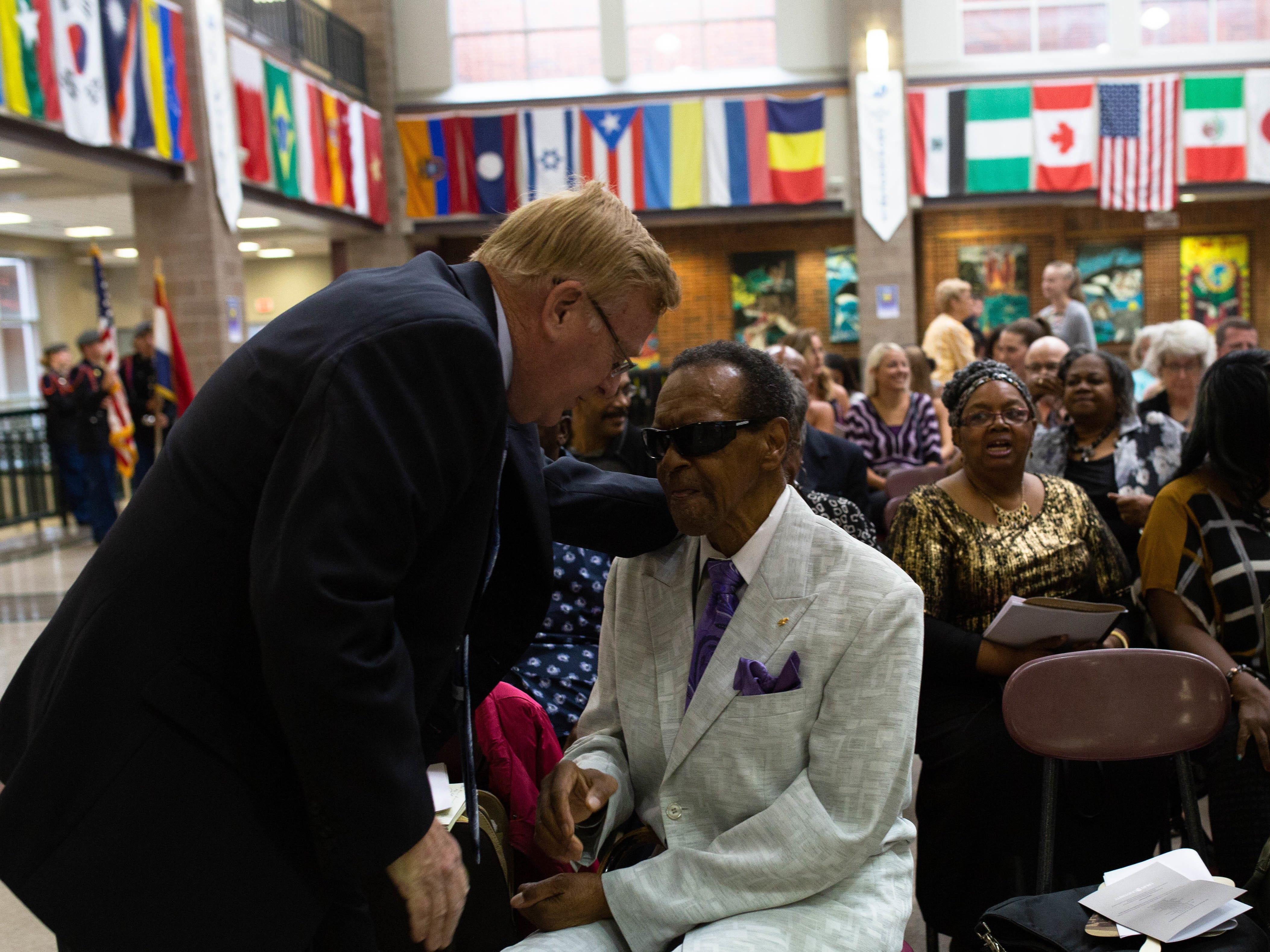 Springfield Mayor Ken McClure, left, talks with former councilman Denny Whayne at a celebration of Rev. Oliver Brown at Central High School earlier this year.
