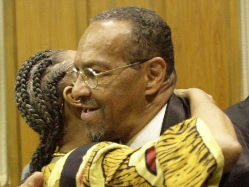 Denny Whayne received a congratulatory hug from his niece Debra Whayne-Allen after being sworn in as Springfield city councilman in this 2001 photo.