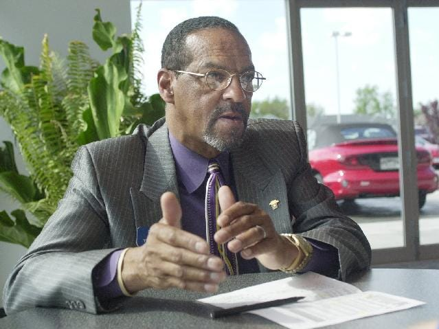 Newly elected Springfield Councilman Denny Whayne talks to a reporter at the Thompson Pontiac dealer on Independence, where he works as a sales and leasing consultant, in this 2001 photo.