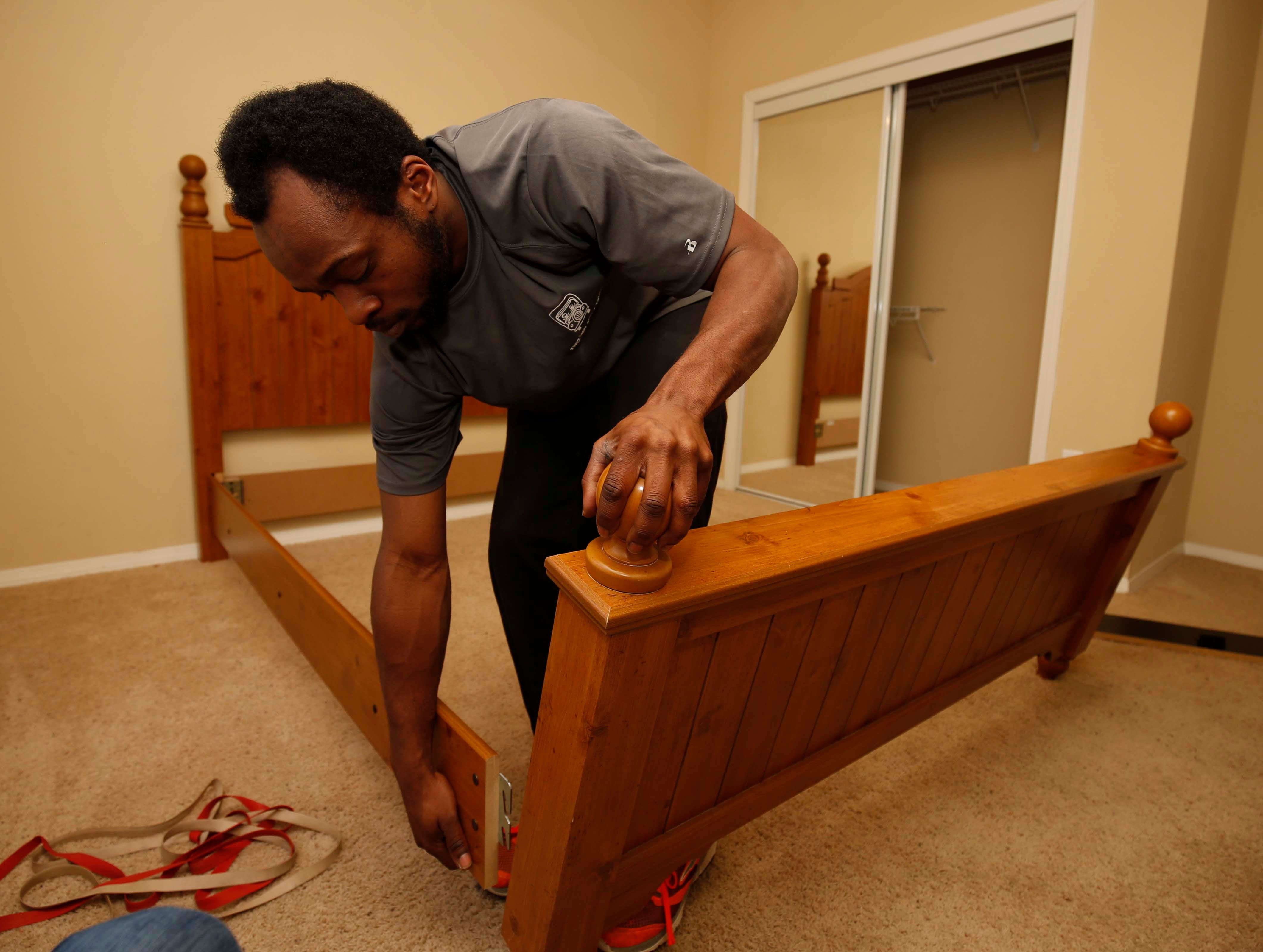 Milton O'Neil of Two Men and a Truck moves furniture donated by Bass Pro Shops to Foster Adopt Connect in Springfield on December 18, 2018.