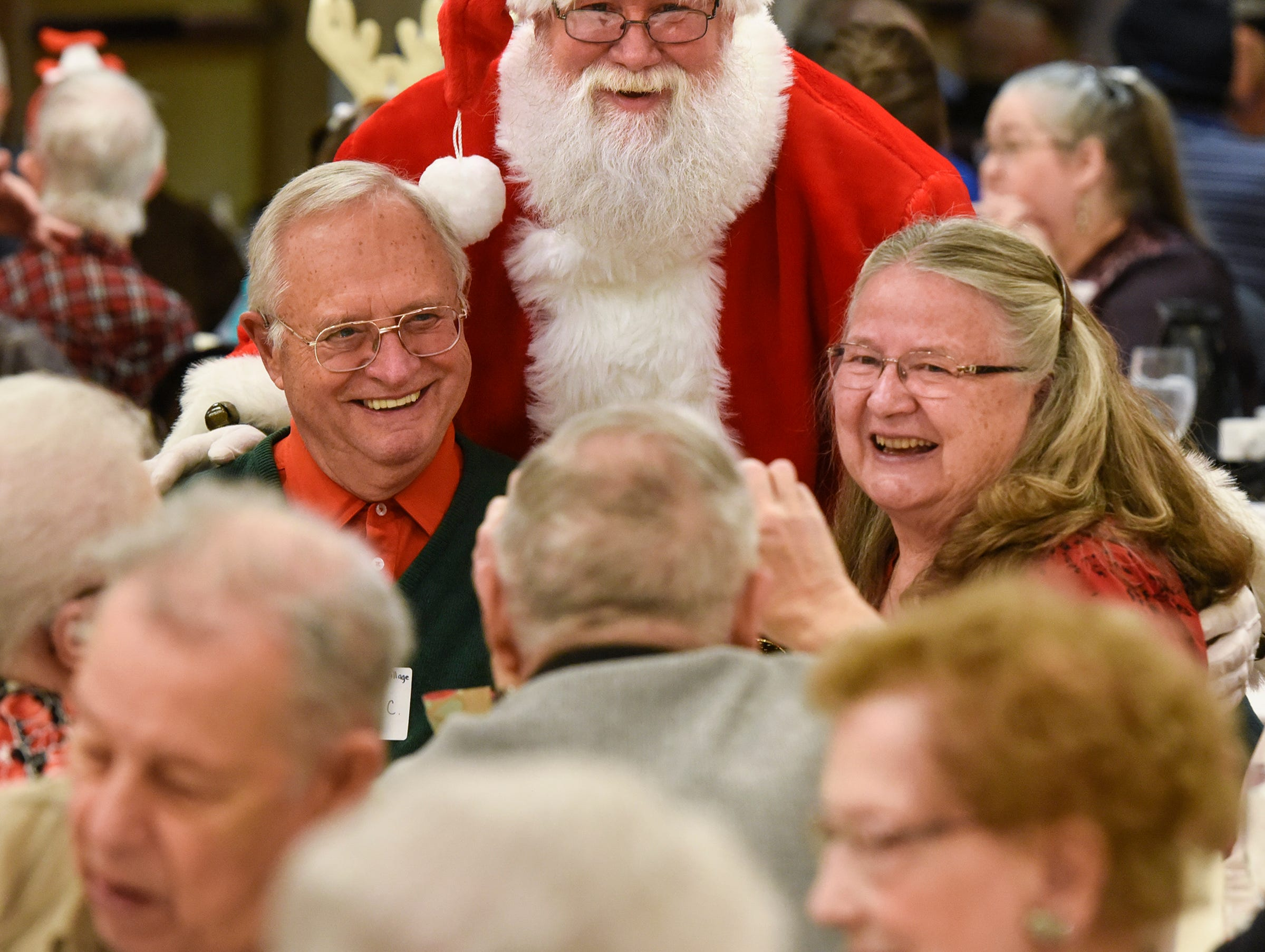 Santa Craig Diedrich poses for photos with guests during the Dinner with Santa event Monday, Dec. 17, in St. Cloud.