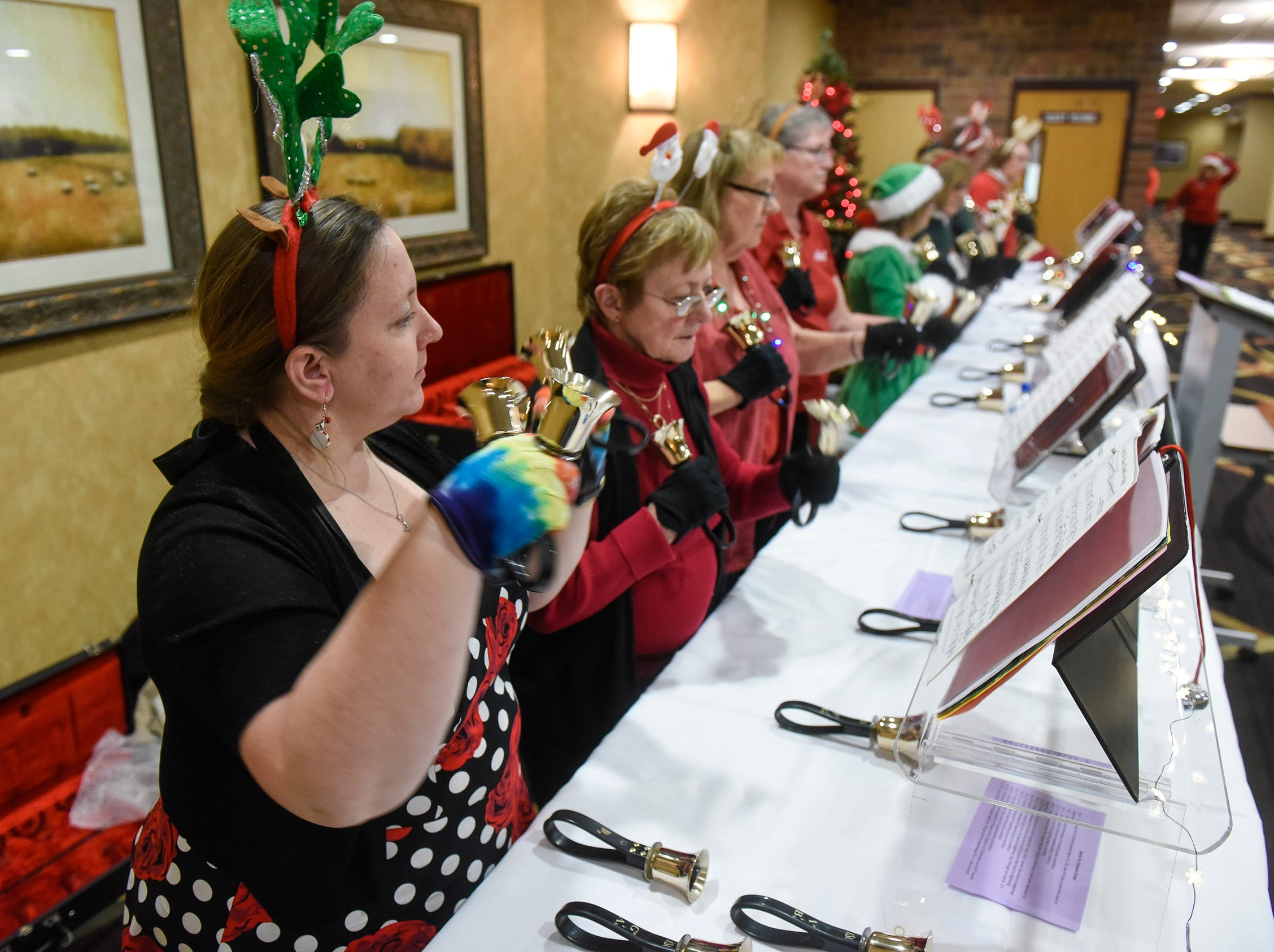 Handbells provide festive music for the Dinner with Santa event Monday, Dec. 17, in St. Cloud.