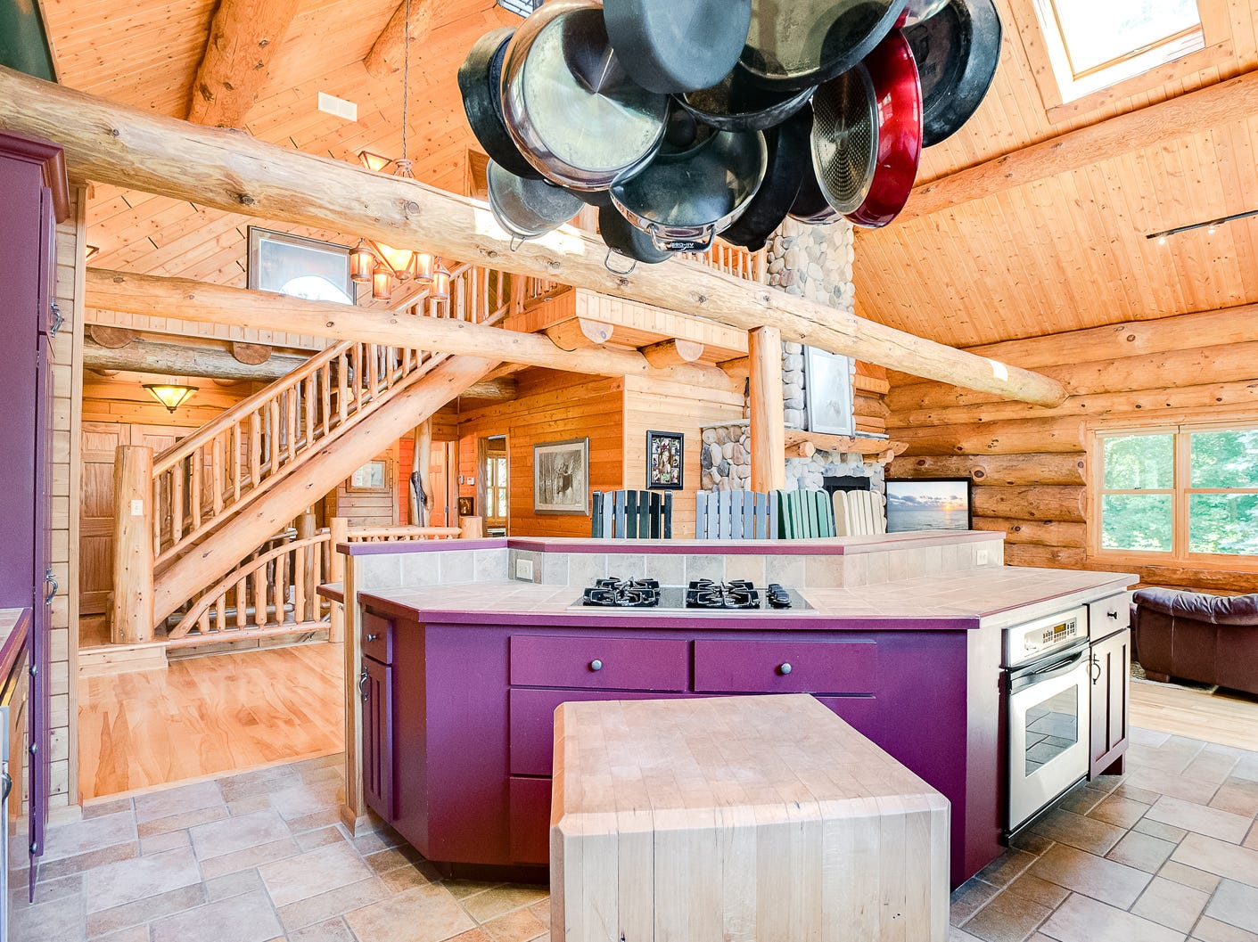 The kitchen is large and open. With its farmhouse sink and cooktop in the island, it allows for easy prep work while visiting with guests and family.