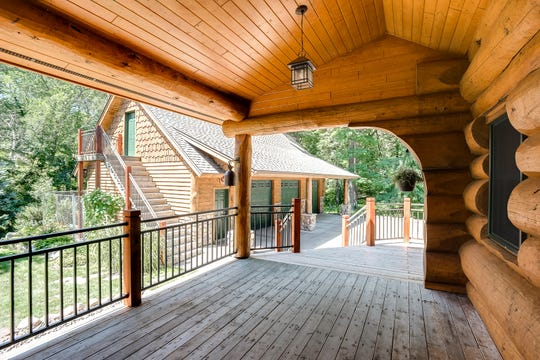 The garage has 10-foot ceilings, a work bench and in-floor heat. An outdoor staircase provides access to the upper bonus room above the garage.