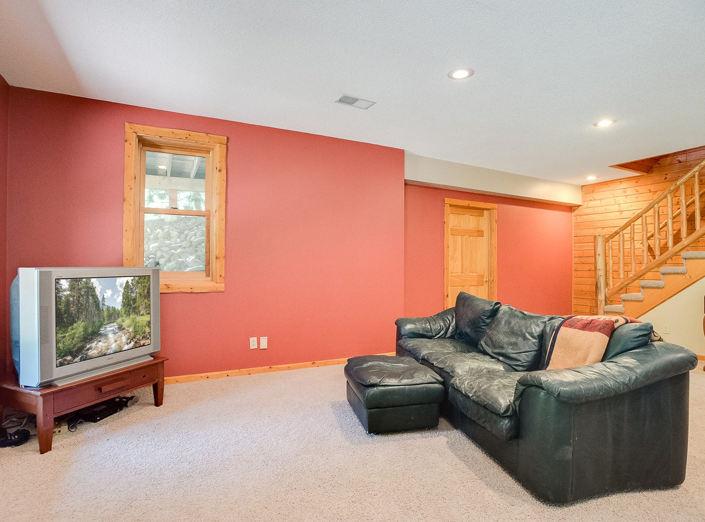 The lower level of the home is finished with a large family room featuring heated floors.