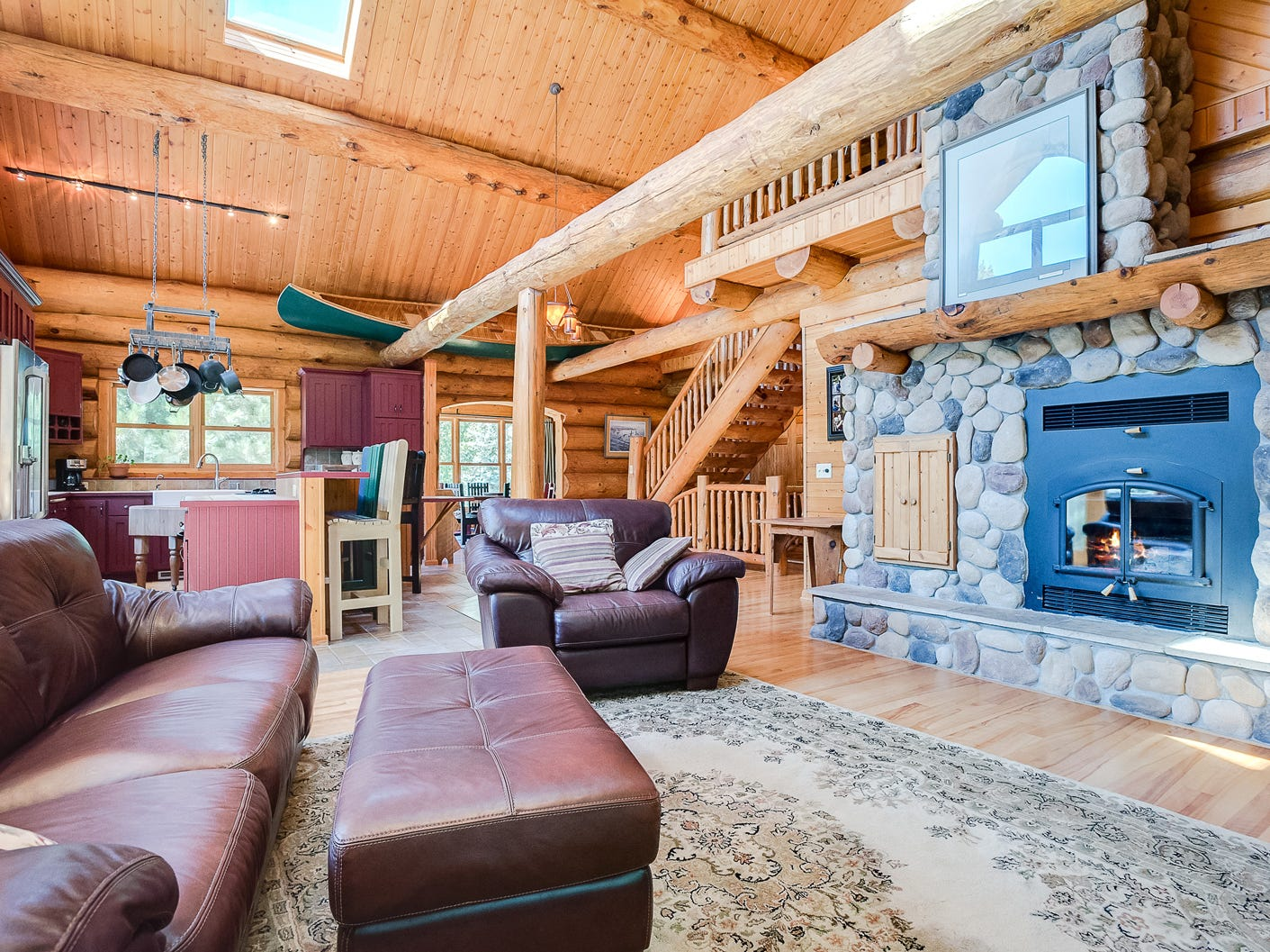 The great room offers spectacular views of the outdoors as well as the loft near the entrance of the home.
