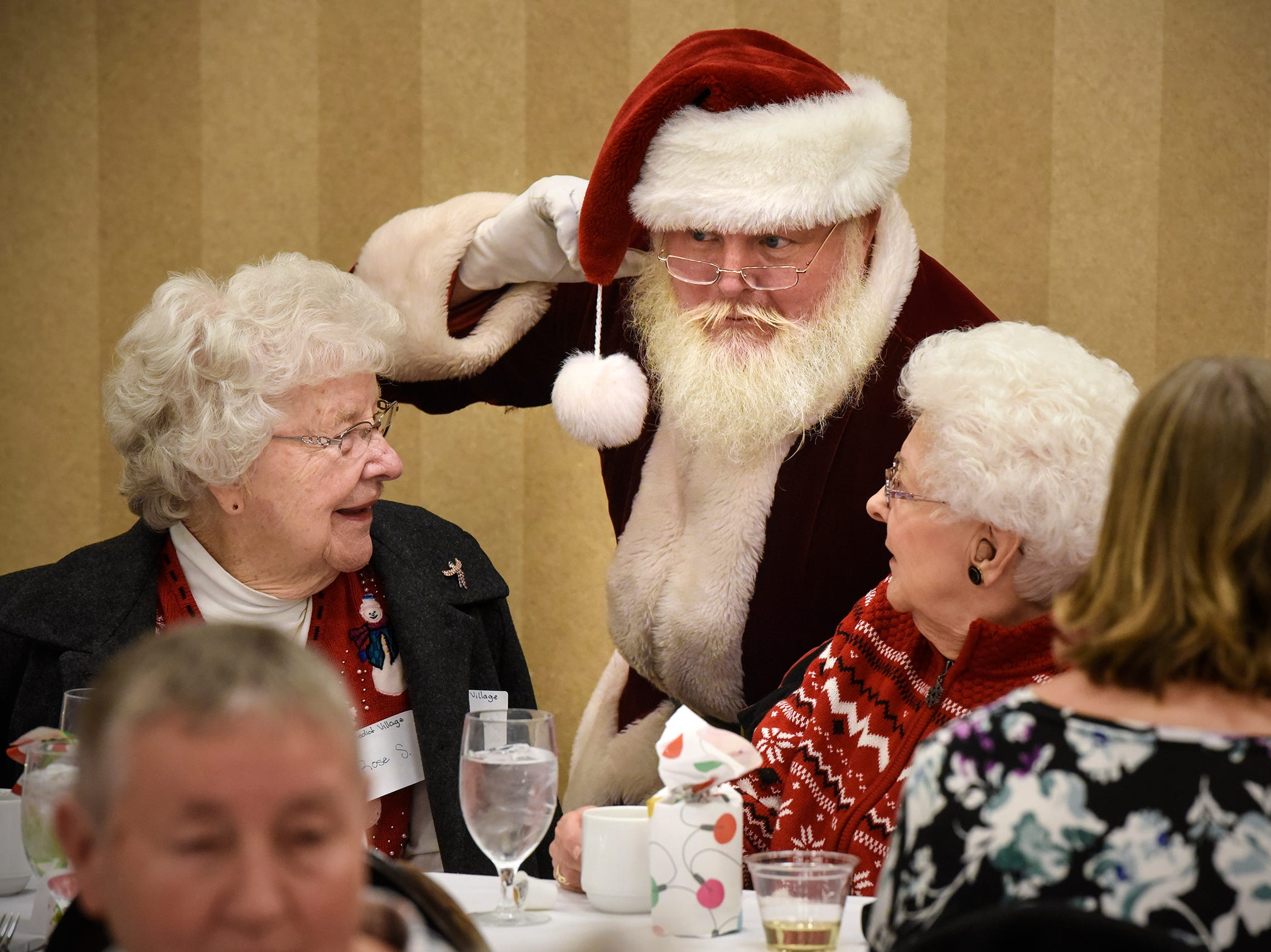 Santa shares some conversation during the Dinner with Santa event Monday, Dec. 17, in St. Cloud.