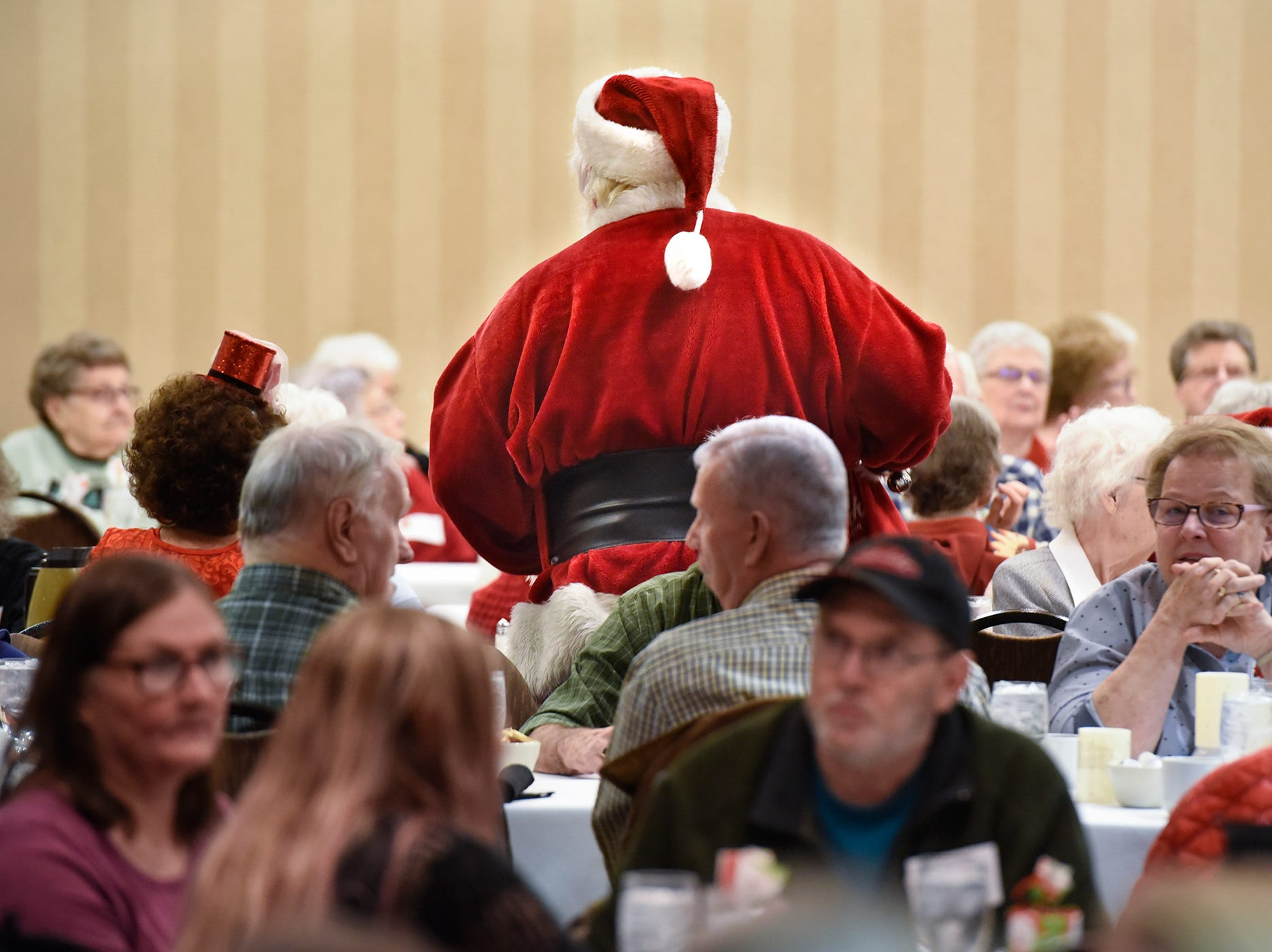 Santa talks with residents during the Dinner with Santa event Monday, Dec. 17, in St. Cloud.