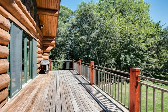 The back side of the home features an 856-square-foot deck facing the waterfront.