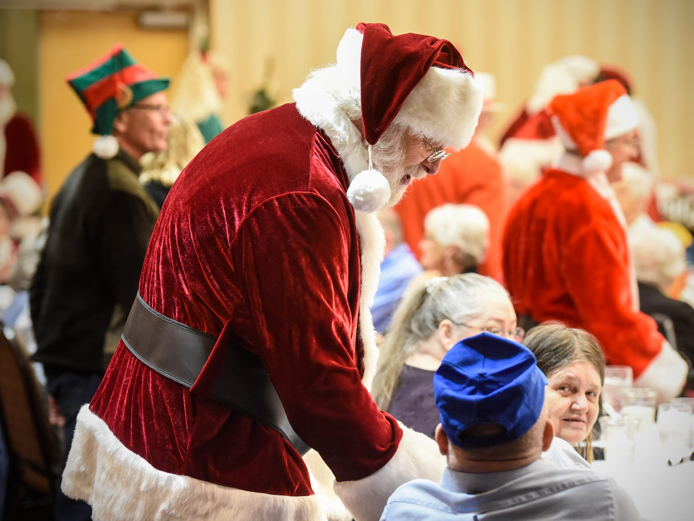 Santa smiles at residents during the Dinner with Santa event Monday, Dec. 17, in St. Cloud.