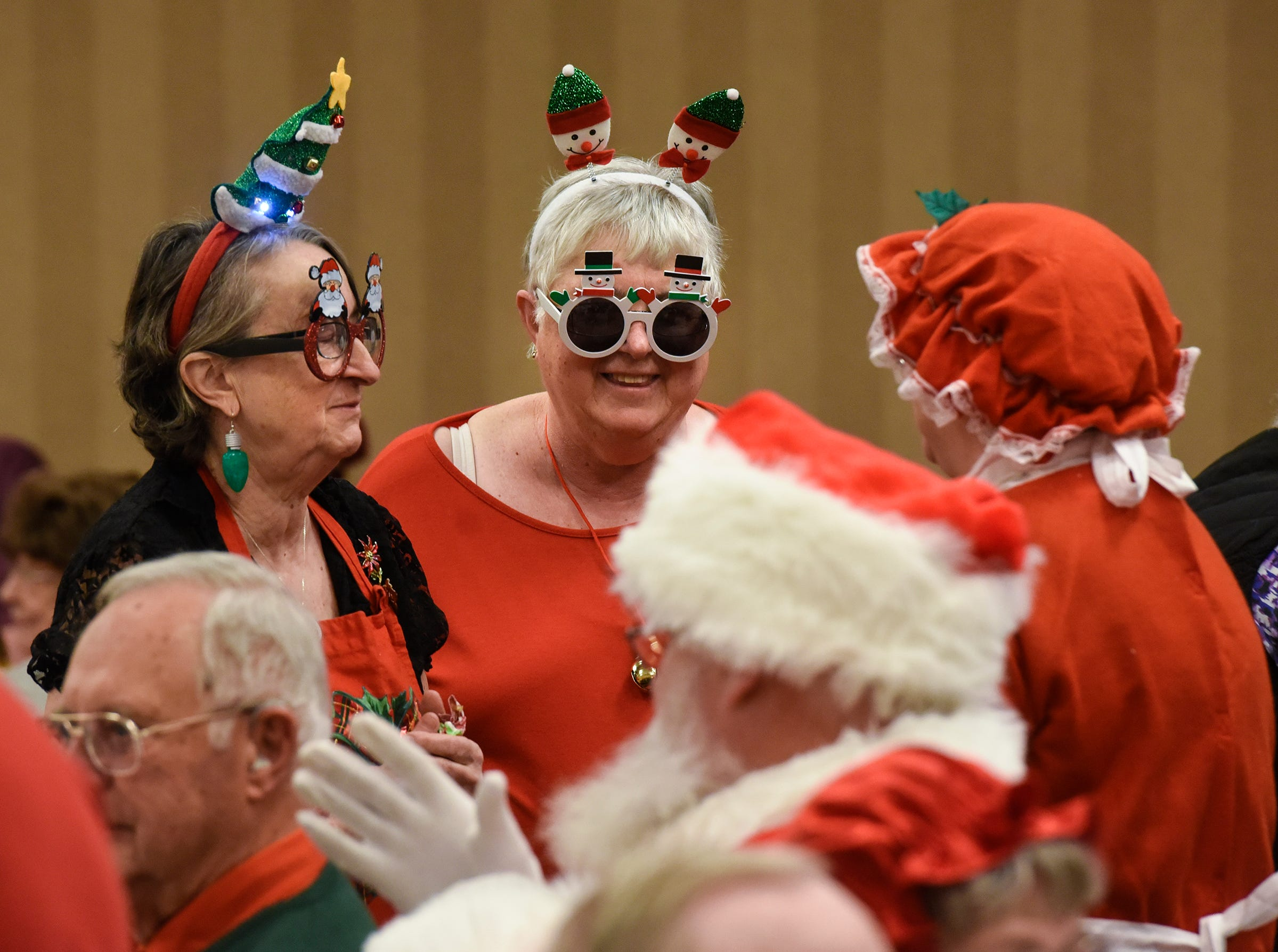 Festive glasses complete the look for volunteers during the Dinner with Santa event Monday, Dec. 17, in St. Cloud.