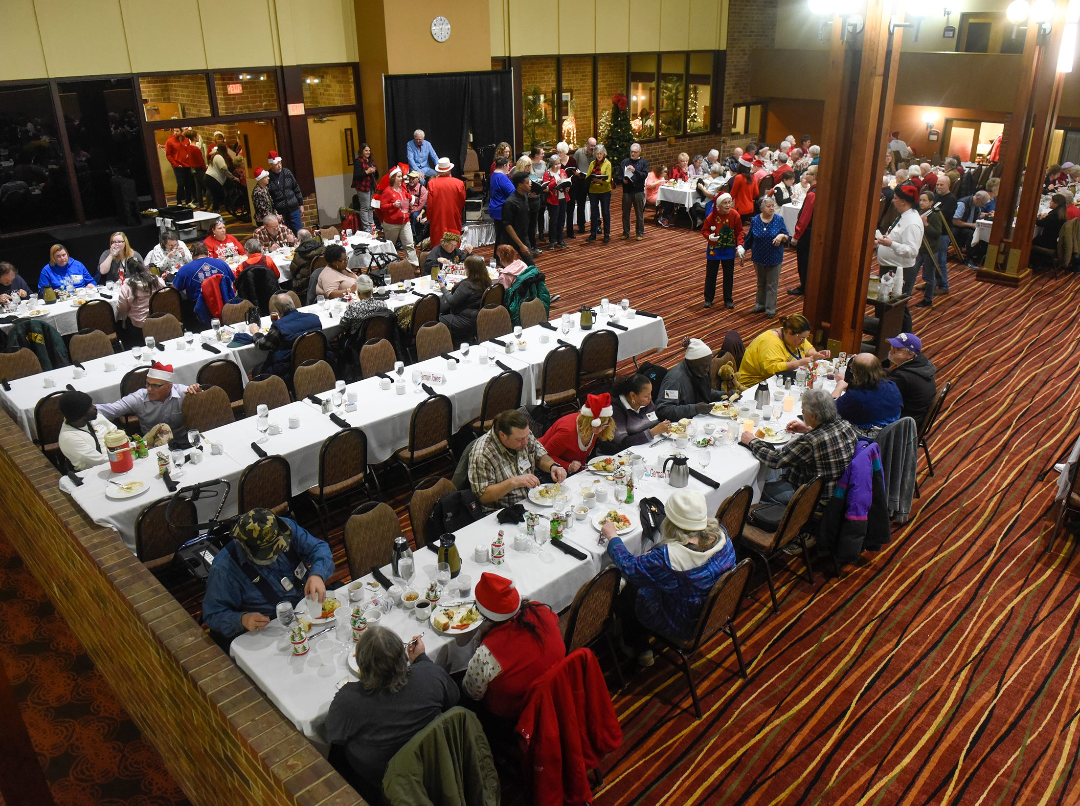 Two large eating spaces were filled for the Dinner with Santa event Monday, Dec. 17, in St. Cloud.
