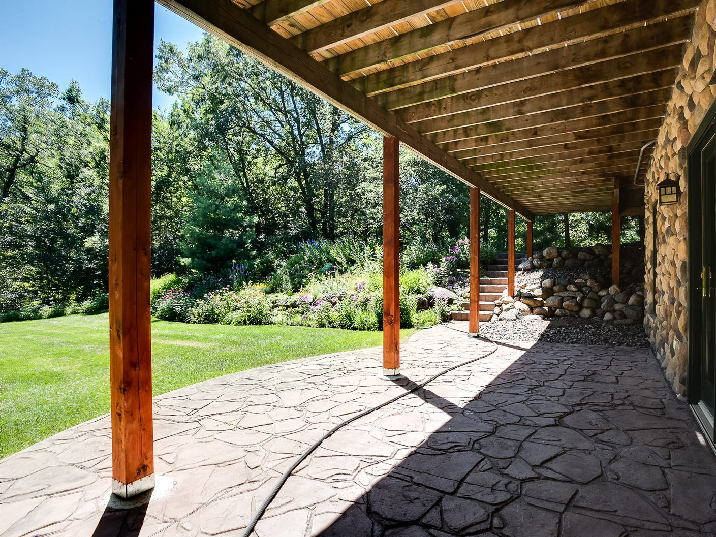 The walk-out basement opens to a large stamped, concrete covered patio.