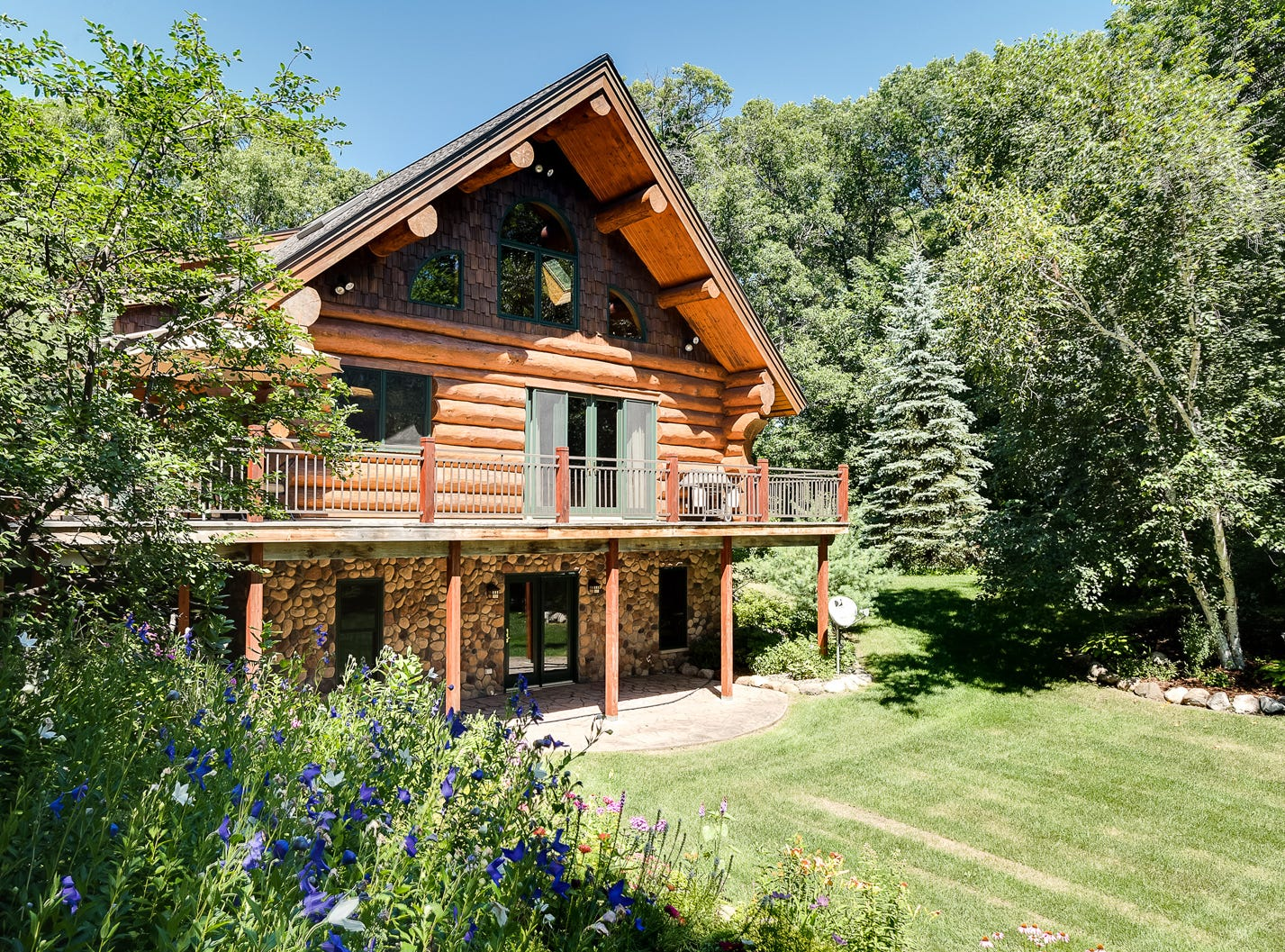 This handcrafted log home sits on three wooded acres of private property and 200 feet of Elk River frontage in Becker.
