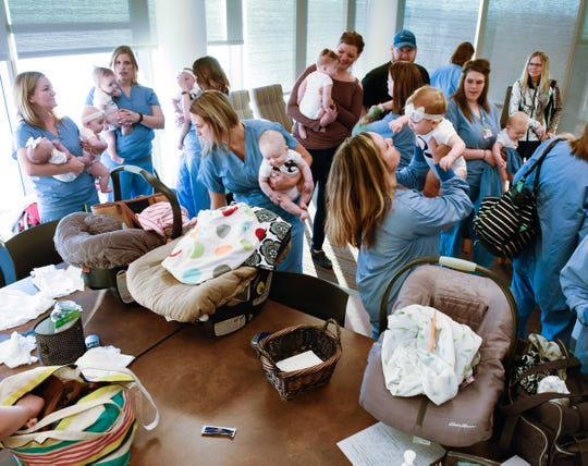 Family Birthing Center staff get ready for a group photo Saturday, Dec. 15, at the St. Cloud Hospital. 30 staff members has 31 babies in 2018.