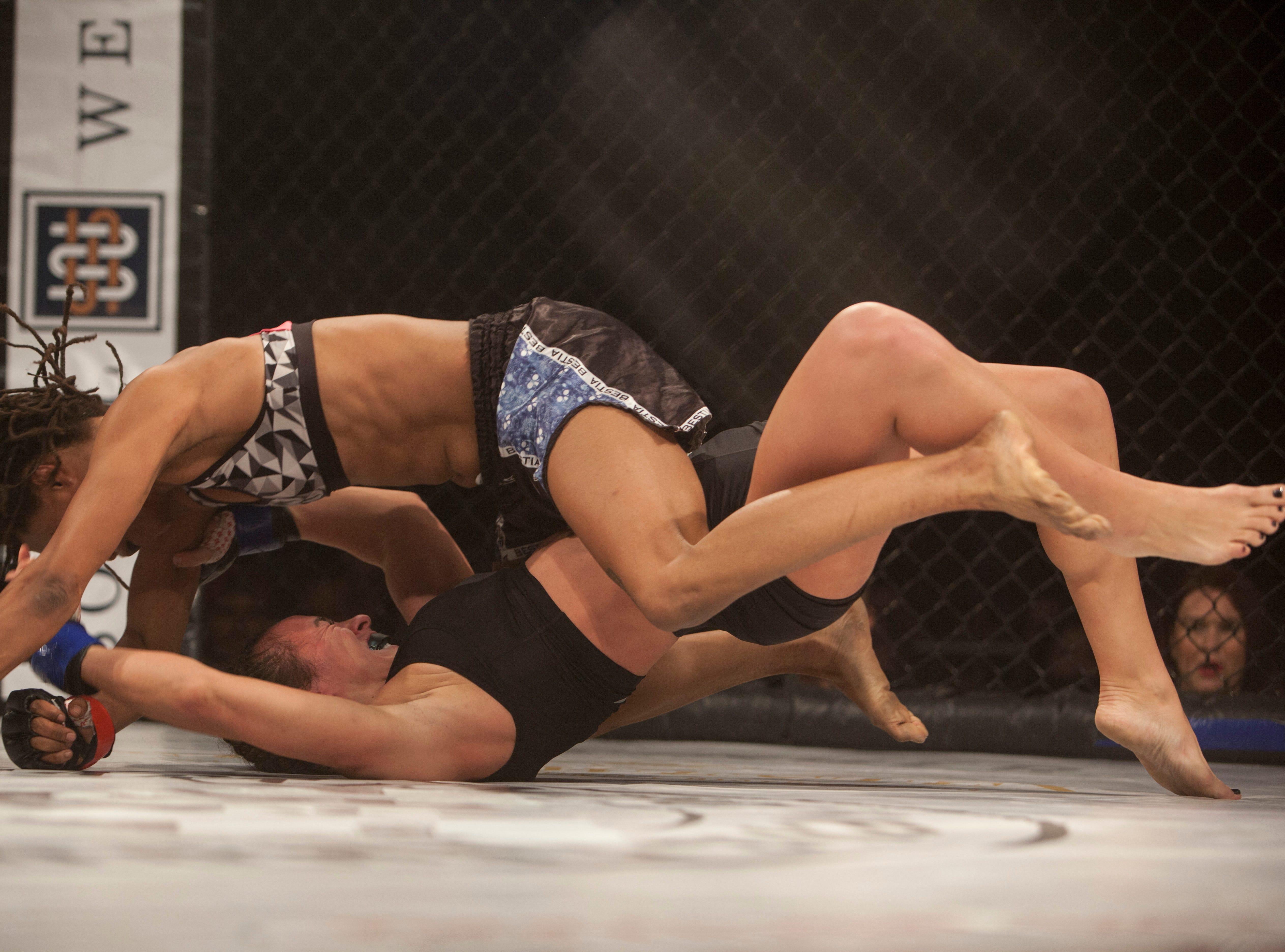 Tamika Jones, in the red corner, defeats Heather Allen during Mayhem in Mesquite at the Casablanca Saturday, Dec. 15, 2018.