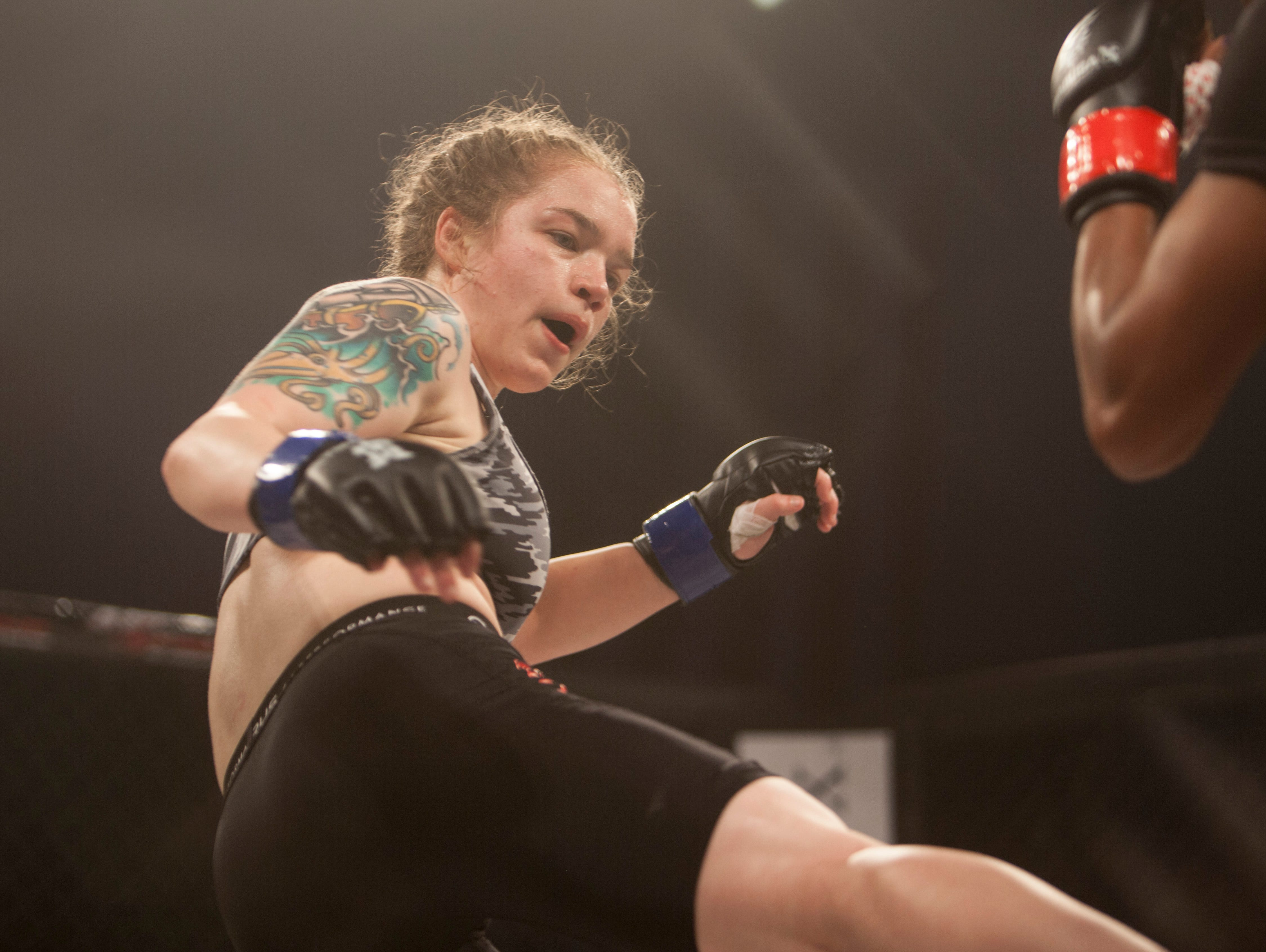 Allison Goodwin, in the blue corner, defeats Antinicia Ragges during Mayhem in Mesquite at the Casablanca Saturday, Dec. 15, 2018.